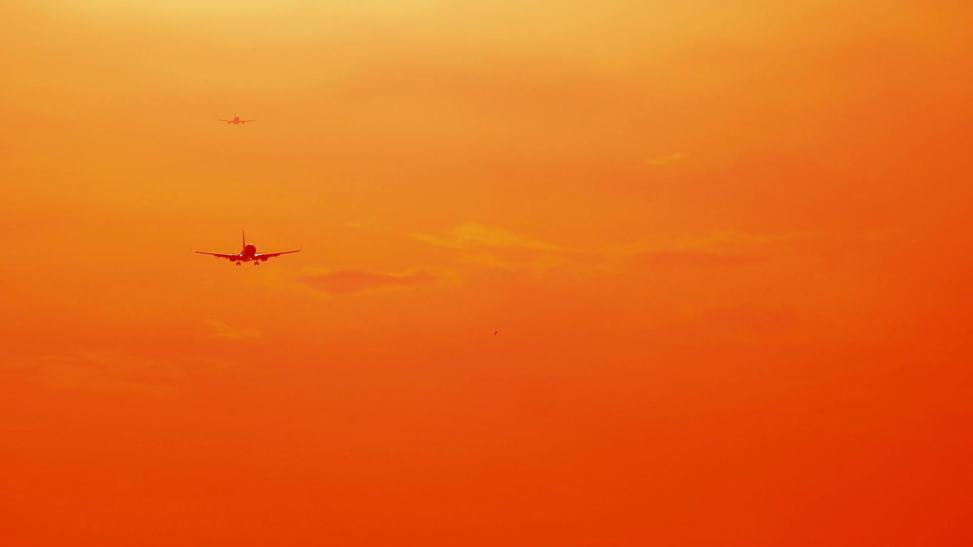 videoblocks-bright-sunny-orange-sunset-sky-with-flying-airplanes-travel-background_bngn5m0uhf_thumbnail-full03